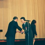 Accepting Award of Recognition from Nihon University Wrestling Club April 2002
